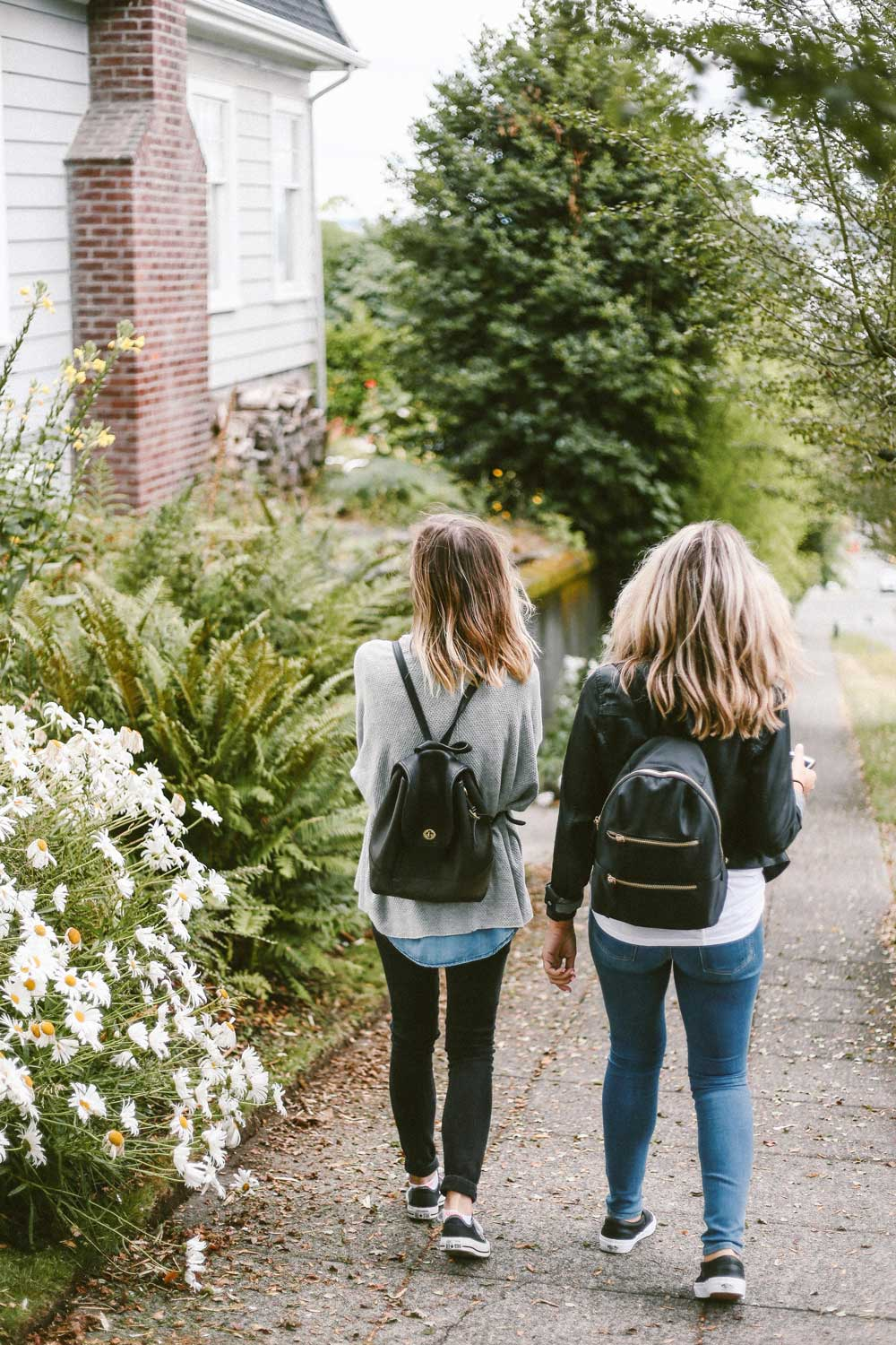 two teenagers walking down vancouver street to school